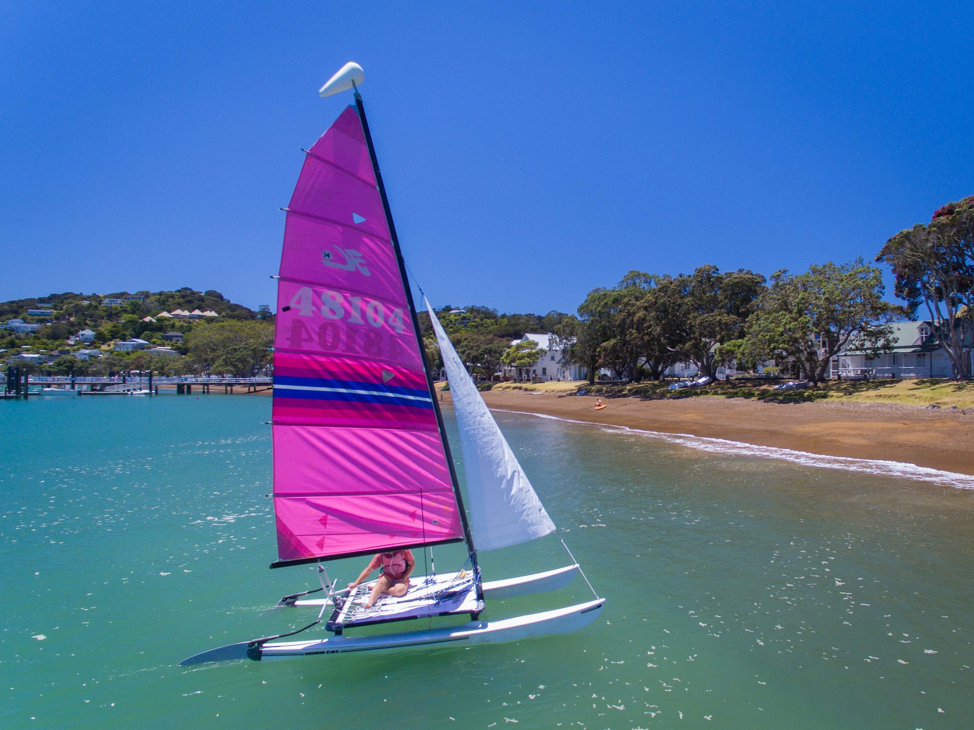 Try sailing on one of our hire Hobie 14 catamarans